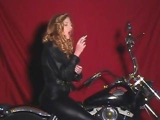 The Queen Inhaling Deeply In Her Full Leather