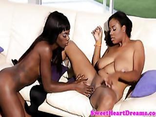 Ebony lesbian fingering before rimming babe