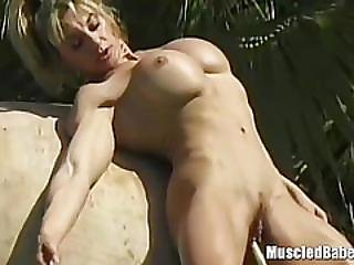 Muscled Lesbians Licking At The Pool