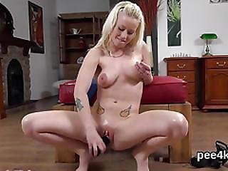 Luscious Girl Is Pissing And Fingering Shaven Snatch