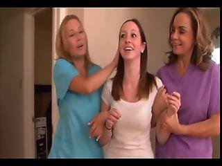 Two Mature Nurses Caring For Teen Girl