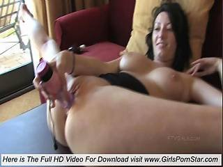 In An Acrobatic Position Sexy Brunette Masturbating With A Vibrator