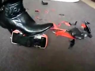 Black High Heeled Boots Crushing Three Toy Cars