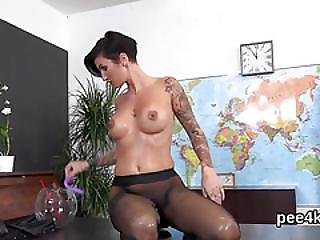 Flawless Cutie Is Pissing And Rubbing Shaved Twat