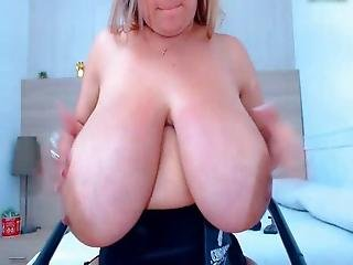Mature Woman Shows Her Huge Boobs
