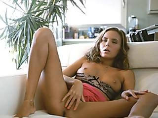 Sexy Brunette Babe Finger Fucks Her Pussy On The Couch