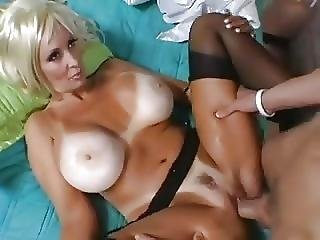 Fake Tits And Tan Lined Milf Takes A Young Cock