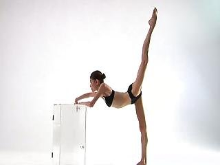 Freakishly Skinny Girl Poses On A Glass Table