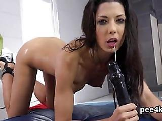 Luscious Kitten Is Pissing And Masturbating Shaved Pussy