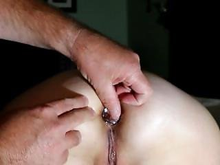 Inserting Butt Plug Close Up