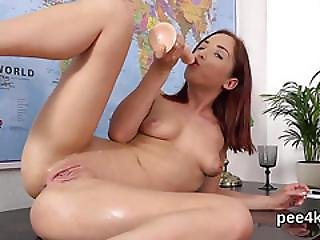 Attractive Cutie Is Peeing And Pleasuring Shaven Cunt