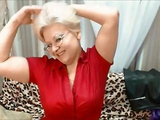 Cute Russian Granny Flexes Her Big Arms On Cam