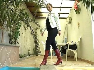 Girl Play In Pool In Jacket And Boots