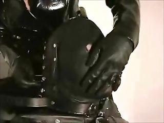 Putting The Slave Into The Leather Hood & Muzzle