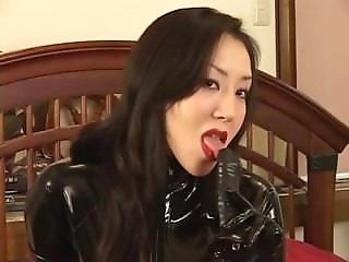 Asian Latex Catsuit Domina Strap-on Fucking Her Slave