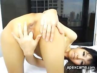 Adorable Asian Minx Shows Off Pussy
