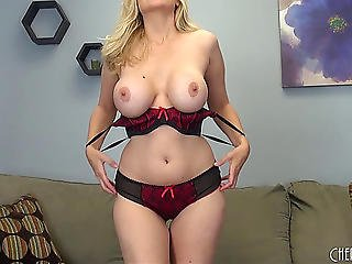 Take A Look At A Teasing Blond Seductively Toying Her Fur Pie