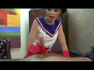 Bossy Cheerleader In Red Gloves Gives A Handjob