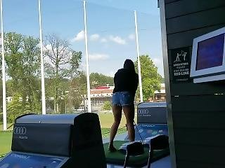 Brunette With Nice Ass And Sexy Legs Bending Over In Shortshorts At Topgolf
