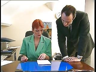 Redheaded Older Secretary Sucks Boss S Cock At Her Desk