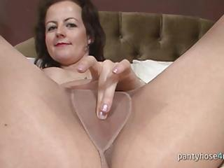 Sexy Mom Masturbates In A Bedroom