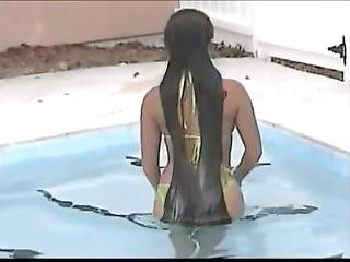 A Woman Of The Long Hair Enters The Pool