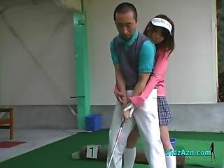 Asian Girl Jerking And Sucking Her Golf Instructor Cock