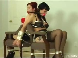 Ludella Hahn And Nyxon Chairtied Together