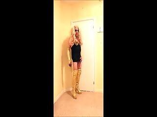 Blonde Tranny Slut Wearing Black Studded Mini Dress And Gold Thigh Boots