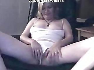 Blonde Chick Masturbates On The Chair
