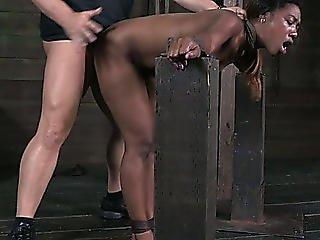 Fastened Up Slim Dark Nympho Receives Her Fur Pie Hammered From Behind