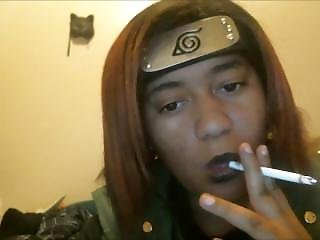 Applying Black Lipstick And Smoking In Cosplay