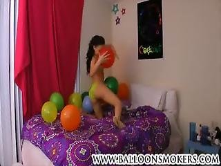Cute Teen Pops Balloons In Bedroom