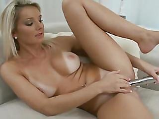 Tanned Blonde Fucks Herself With A Toy On The Sofa