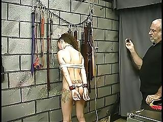 Chick With Tats And A Wild Mane Of Hair Gets Her Ass Beat With Horsehair Whip