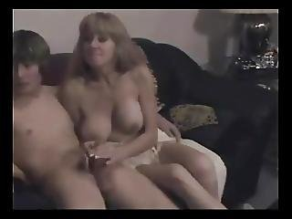 Mature Woman Gives A Teen Boy A Hand Job