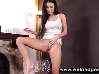 Messy Pissing Fun For Black Haired Babe
