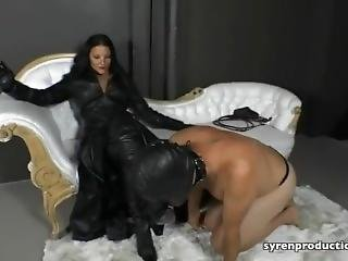 Domina In Leather Smoking With Her Human Ashtray