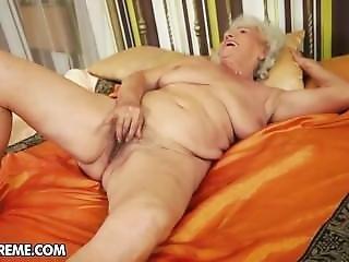 Grandma Norma Masturbating On A Bed