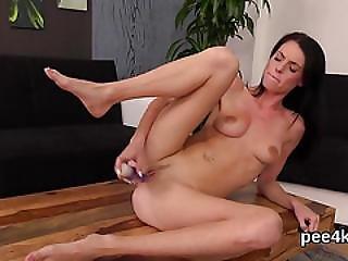 Stellar Teenie Is Pissing And Masturbating Shaven Slit