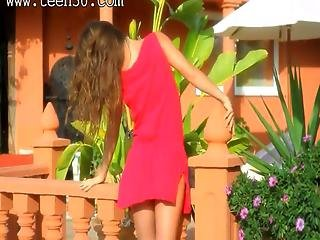 Gorgeous Model In Red Teasing Outdoors