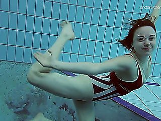 Curvy Pale Skin Redhead Hottie In The Water Swims Undressed