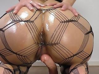 Big Oiled Ass Rides A Dildo