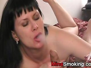 Housewife Gives Blowjob While Smoking A Cigarette