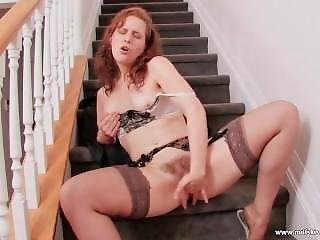 Ginger Milf Fucks Her Hairy Pussy On The Stairs