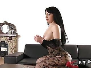 Fantastic Cutie Is Pissing And Rubbing Shaved Slit