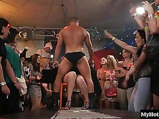 As The First Stripper Sits Naked On The Stage Runway, A Younger Male