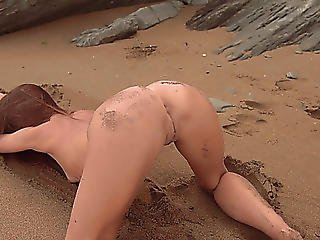 Erotic And Hot Stripped Photo Discharge On A Sandy Beach