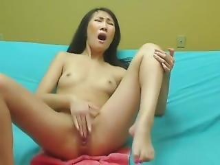Horny Asian Babe Moans Loudly In Ecstasy As She Masturbates On Webcam