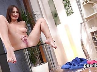 Stellar Nympho Is Peeing And Fingering Shaven Snatch
